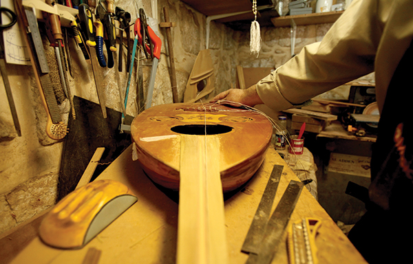Ali Hassanein, a 54-year-old oud maker works in Ramallah. Every day life in Palestine. (Photo MaanImages)
